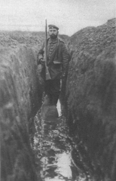 Photo: Soldiers in a flooded connecting trench